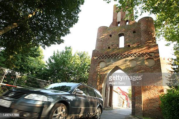 A car drives through the Berliner Tor a 15th century city gate on July 25 2012 in Mittenwalde Germany Mittenwalde a town with approximately 2000...