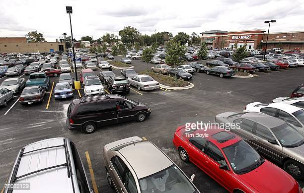 A car drives through the parking lot outside the new WalMart store September 27 2006 in Chicago Illinois Chicago opened its first WalMart today in...