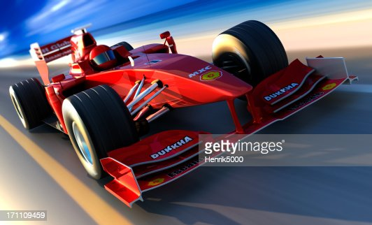 F1 car driving along beach, clipping path included