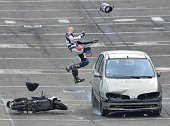 A car driving at 70 km/h hits a dummy on a scooter in Le Mans northwestern France on October 15 during a crash test organized to raise awareness...