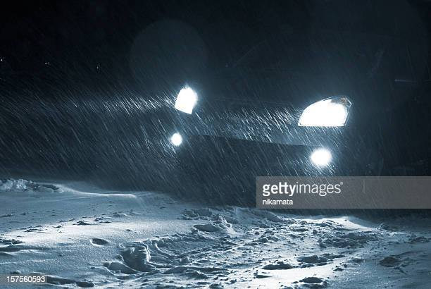 Car driving in a Snowstorm