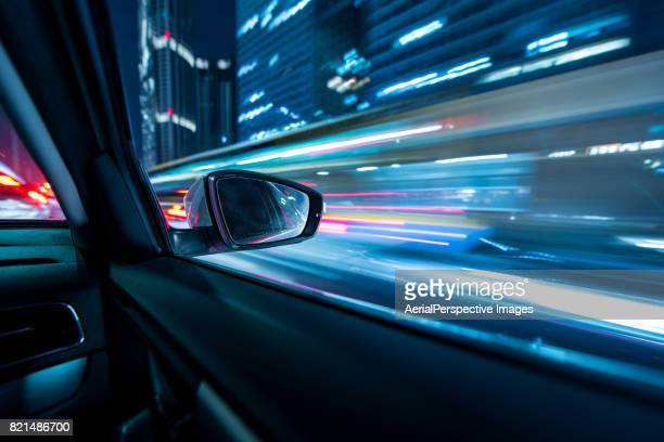 Car Driving in Downtown at Night