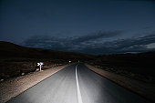 Car driving on highway at night, view of road