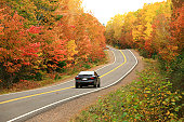 Car Driving on Remote Appalachian Highway in Fall