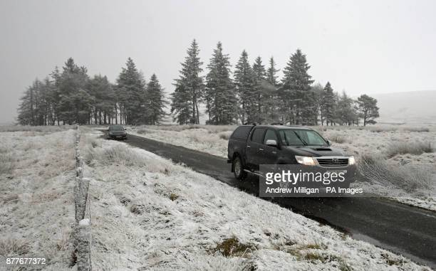 A car driving through light snow in Sheriffmuir near Dunblane as wintry showers are forecast for many parts of Scotland