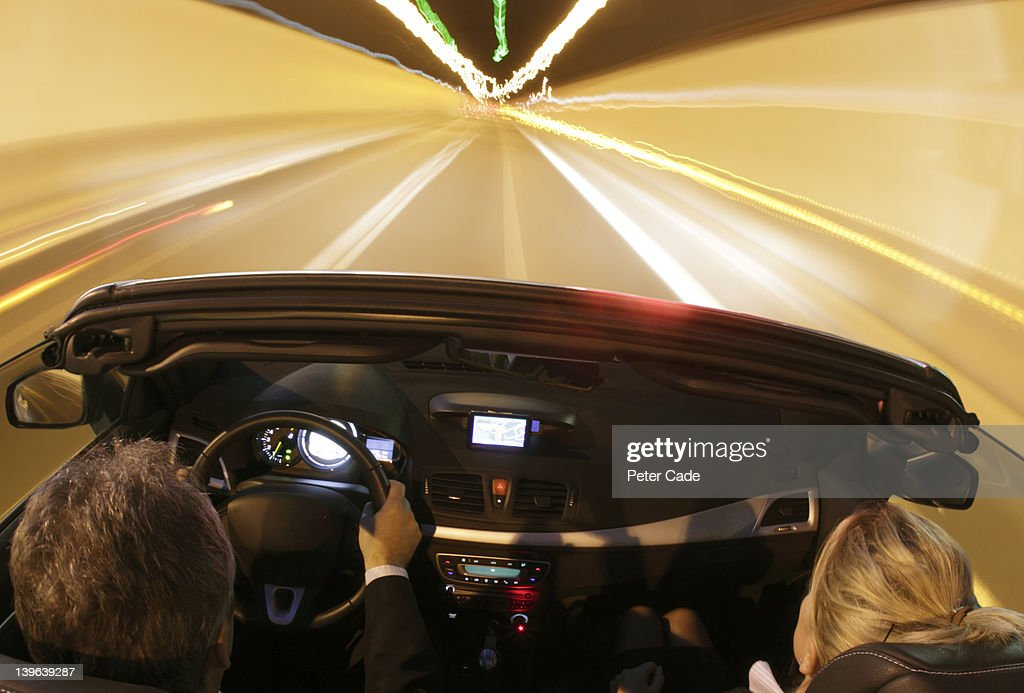 car driving through tunnel at night : Stock Photo