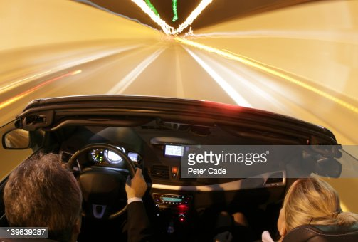 car driving through tunnel at night : Stock-Foto