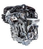 Modern downsized three cylinder cylinder car engine isolated on white background
