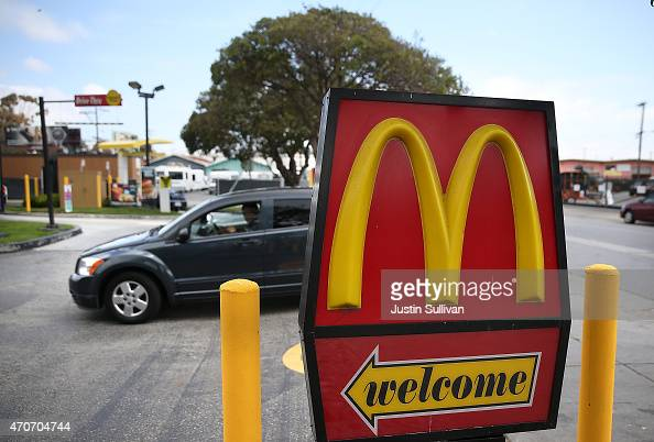 A car enters a McDonald's restaurant on April 22 2015 in San Francisco California McDonald's reported a decline in first quarter revenues with a...