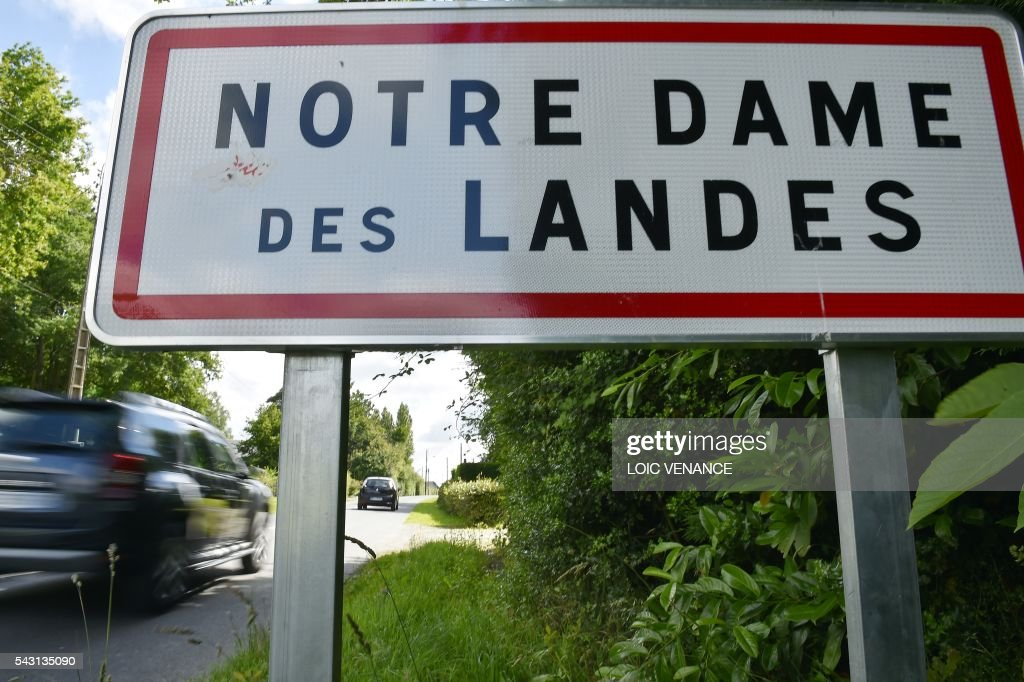 A car enters the city of Notre-Dame-des-Landes on June 26, 2016, during a local referendum organized in Loire Atlantique to transfer of the Nantes Atlantique airport to Notre-Dame-des-Landes. Nearly One million people living in France's Loire-Atlantique department are voting in a referendum which poses the question 'Are you in favour of the project to transfer the Nantes-Atlantique airport to the municipality of de Notre-Dame-des-Landes?' to voters. The referendum was organised by the French executive power hoping to find a solution to the issue which has dragged on for 50 years. / AFP / LOIC
