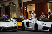 Car enthusiasts watch Lamborghini Aventadors drive through Knightsbridge on August 8 2014 in London England Tourists and car enthusiasts have been...