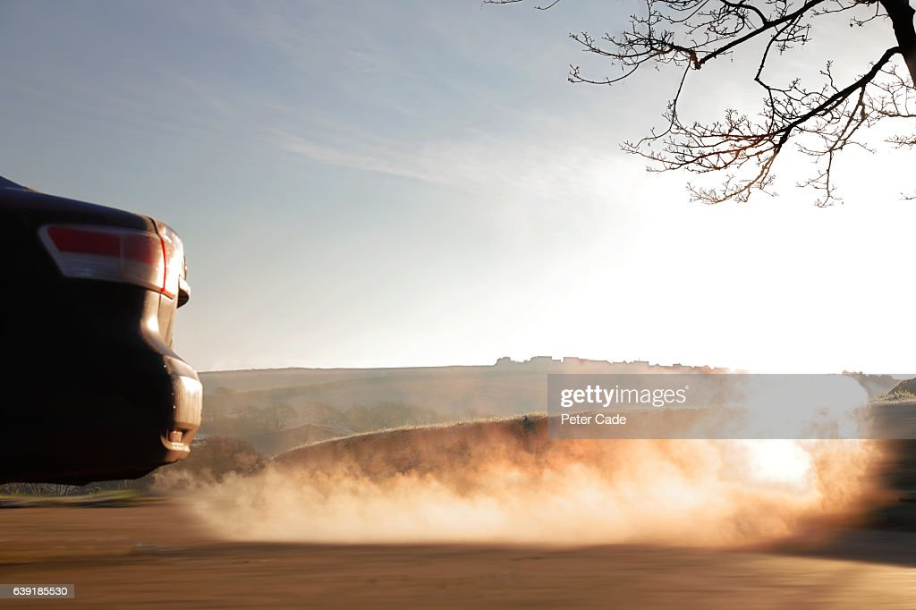 Car exhaust on a cold morning : Stock Photo