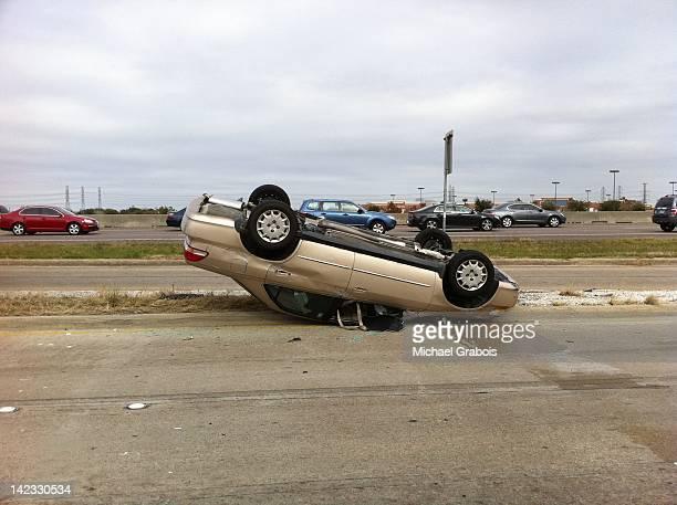 Car fallen upside-down on road