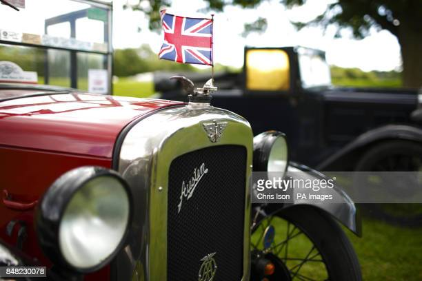 A car flies a small Union Jack at the 50th Austin Seven rally at the National Motor Museum in Beaulieu Hampshire