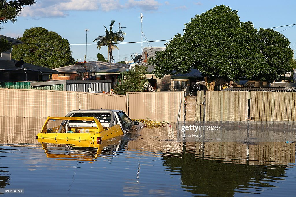 A car floats in a flooded street as parts of southern Queensland experiences record flooding in the wake of Tropical Cyclone Oswald on January 29, 2013 in Bundaberg, Australia.Four deaths have been confirmed and thousands have been evacuated in Bundaberg as the city faces it's worst flood disaster in history. Rescue and evacuation missions continue today as emergency services prepare to move patients from Bundaberg Hospital to Brisbane amid fears the hospital could lose power.