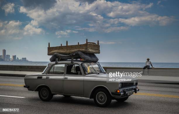 A car from the Soviert era is driven along the Malecon Havana's waterfront on October 16 2017 With three decades of close alliance with the Soviet...