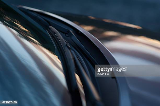 Car front with twilight reflection