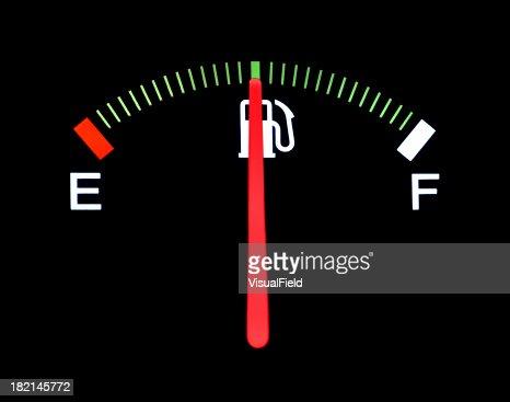Car fuel gauge shows half full on black background