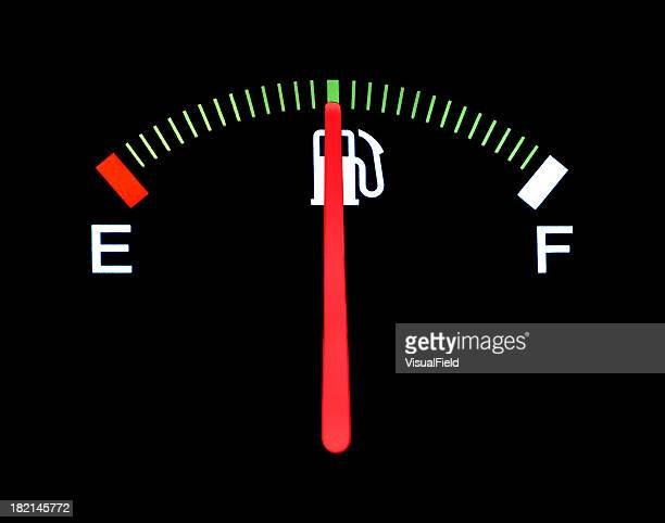 Car fuel gauge shows half full on black background