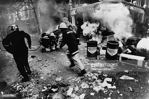 A car fuel tank explodes on the Charing Cross Road during the Poll Tax Riots in London 31st March 1990