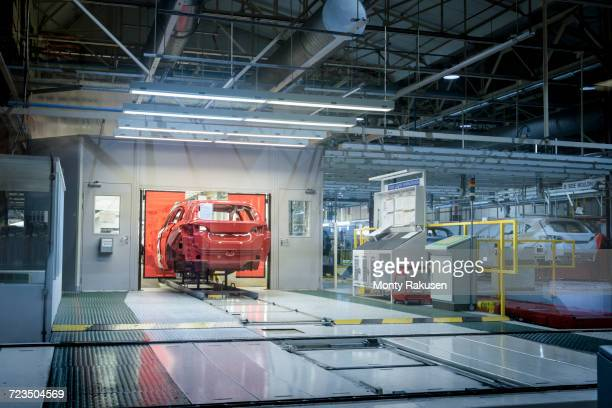 Car going in to paint dryer in car factory