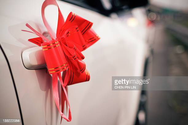 Car handle on red bow