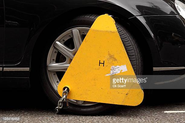 A car has a wheel clamp attached in Kensington on August 17 2010 in London England A Government ruling which will come into force in November will...