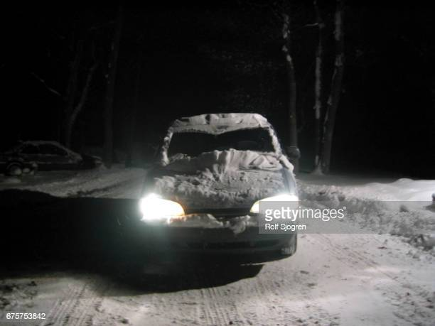 Car, head on, at night with headlights on, snowy road