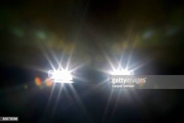 A car headlights illuminated at night