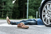 Male person got hit by a car, focus on shoehttp://shrani.si/f/3i/z0/3l6ClGqd/untitled-1.jpg
