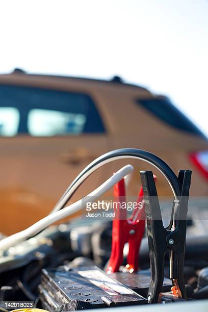 car hood and jumper cables on car battery