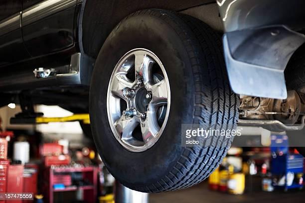Car in auto mechanic shop
