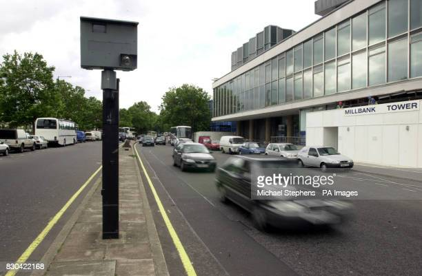 A car in Central London passes a speed camera The Government played down claims that traffic laws could be thrown into chaos after cases against two...