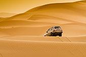 Car in sand dunes