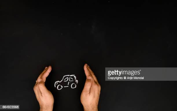 Car Insurance Concept man protecting car with enough blank copy space