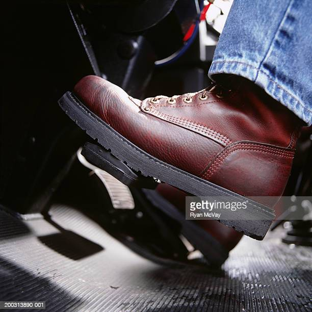 Car interior, close-up of foot on pedal,