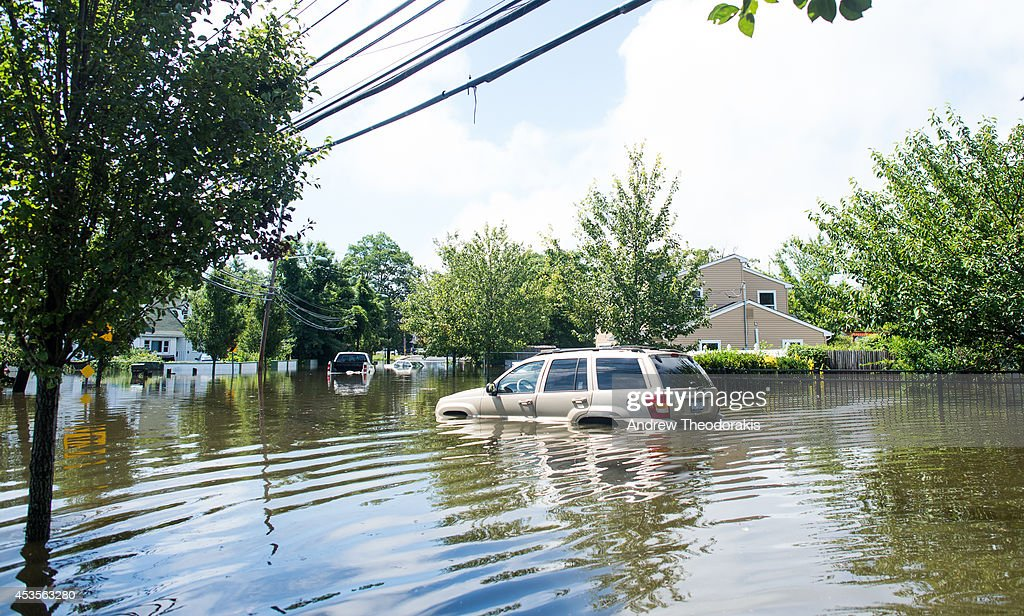 A car is abandoned on a flooded Brooke Ave following heavy rains and flash flooding August 13, 2014 in Bayshore, New York. The south shore of Long Island along with the tri-state region saw record setting rain that caused roads to flood entrapping some motorists.