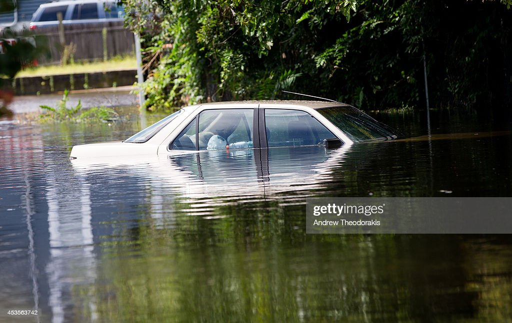 A car is abandoned on a flooded Brooke Ave following heavy rains and flash flooding on August 13, 2014 in Bayshore, New York. The south shore of Long Island along with the tri-state region saw record setting rain that caused roads to flood entrapping some motorists.