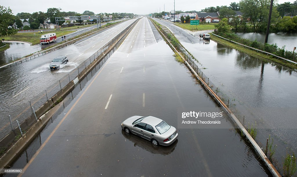 A car is abandoned on a flooded street at Sunrise Highway following heavy rains and flash flooding August 13, 2014 in Bayshore, New York. The south shore of Long Island along with the tri-state region saw record setting rain that caused roads to flood entrapping some motorists.