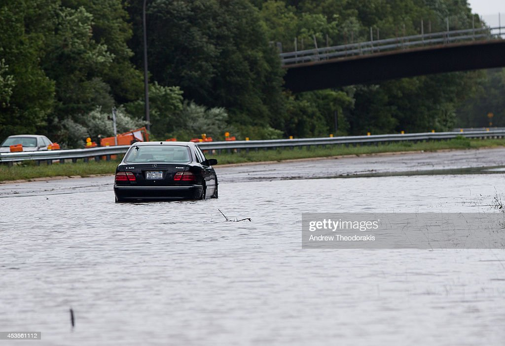 A car is abandoned on the Southern State Parkway following heavy rains and flash flooding August 13, 2014 in Islip, New York. The south shore of Long Island along with the tri-state region saw record setting rain that caused roads to flood entrapping some motorists.