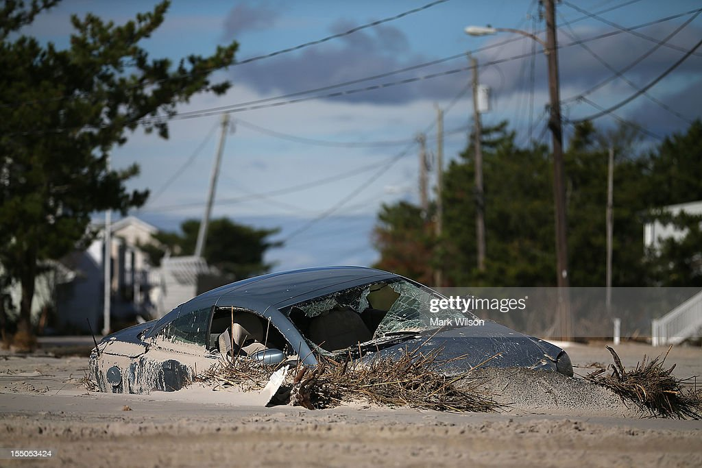 A car is buried in sand that was washed in from Hurricane Sandy on October 31, 2012 in Long Beach Island, New Jersey. Earlier in the week Hurricane Sandy made landfall on New Jersey coastline bringing heavy winds and record floodwaters.