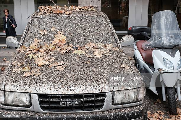 A car is covered by birds drops on November 17 2015 in Rome where millions of migratory starlings nest every evening Weekend rain washed away the...