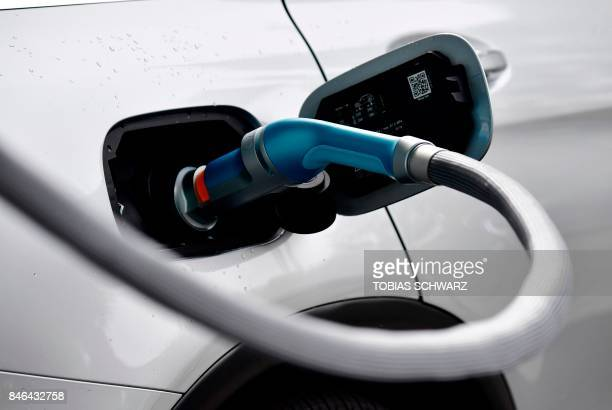 A car is fueled with gaseous hydrogen at the Frankfurt Auto Show IAA in Frankfurt am Main central Germany on September 13 2017 This year's fair...