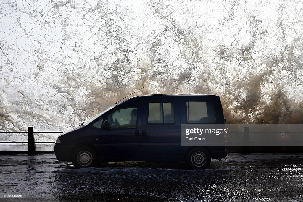 A car is hit by a wave on February 8, 2016 in Newhaven, East Sussex. Storm Imogen is the ninth named storm to hit the UK this season. This year's storms are being named in an effort by the Met Office and Met Eireann to increase public awareness and safety. They were named by public ballot and there are no names for the letters Q, U, X, Y and Z.