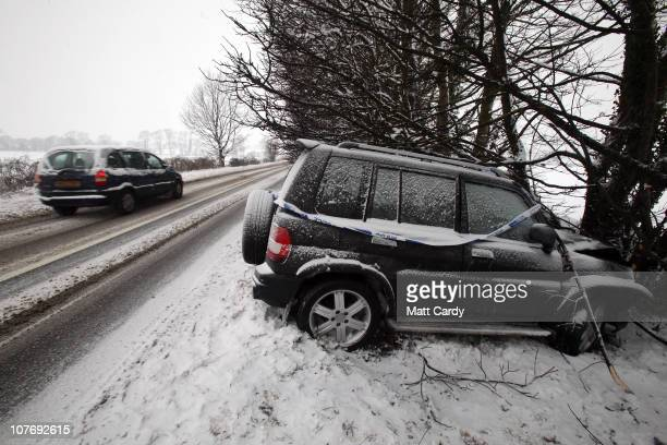 A car is left abandoned after crashing on a snow covered road in the Mendips on December 20 2010 near Wells United Kingdom Heavy snow is bringing...