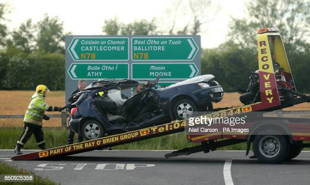 A car is loaded onto a lorry on the N78 close to Athy Co Kildare after two people died and a third was seriously injured in a road crash