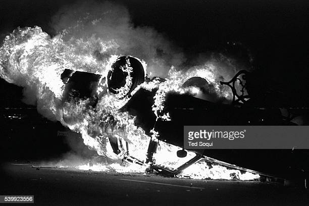 A LAPD car is overturn and set ablaze near the LAPD headquarters in downtown Los Angeles Los Angeles has undergone several days of rioting due to the...