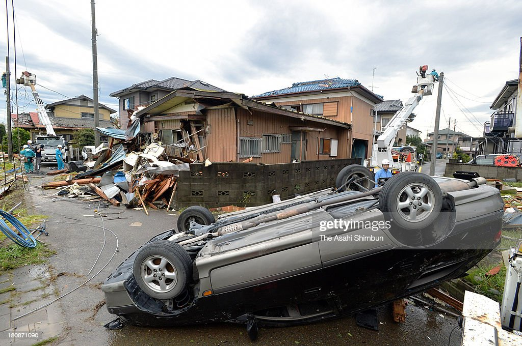 A car is overturned by a strong wind triggered by typhoon Man-Yi approaching on September 16, 2013 in Kumagaya, Saitama, Japan. The storm hit land near Toyohashi, Aichi Prefecture, before 8 a.m. and moved along Honshu throughout the day, damaging buildings, disrupting transportation and causing blackouts, three killed and five missing.