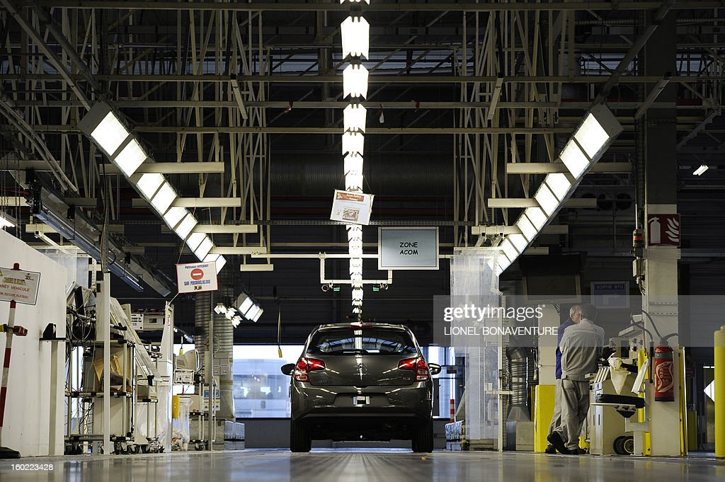 A car is parked at an assembly line on January 28, 2013 at the PSA Peugeot Citroen carmaker plant of Aulnay-sous-Bois, a Paris' suburb, as on-strike workers occupy the factory to protest against plans to sell the plant and lay off thousands of employees. AFP PHOTO LIONEL BONAVENTURE