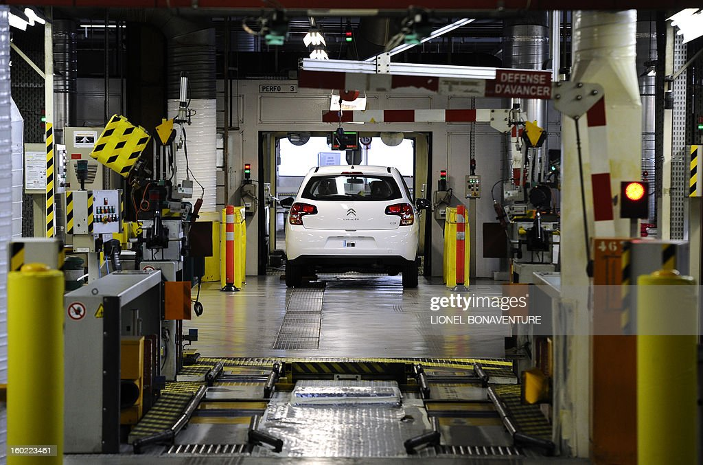 A car is parked at an assembly line on January 28, 2013 at the PSA Peugeot Citroen carmaker plant of Aulnay-sous-Bois, a Paris' suburb, as on-strike workers occupy the factory to protest against plans to sell the plant and lay off thousands of employees.